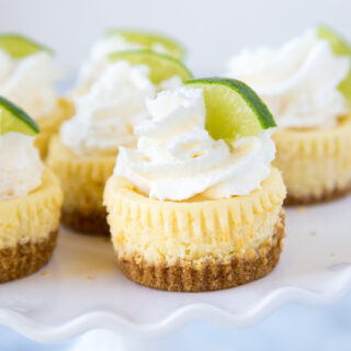 A close up of cheesecake on a plate, with Cheesecake and Lime