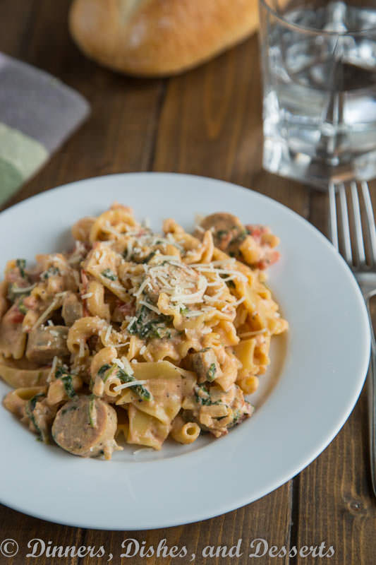 Creamy Sausage Spinach Pasta - a quick and easy meal the whole family will love. Pasta, sausage, and spinach in a creamy tomato sauce.