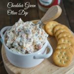 Cheddar Green Olive Dip – A creamy, cheesy, salty green olive, dip that is great warm or cold.