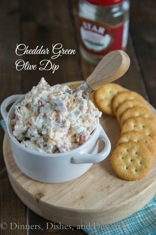 Cheddar Green Olive Dip - A creamy, cheesy, salty green olive, dip that is great warm or cold.