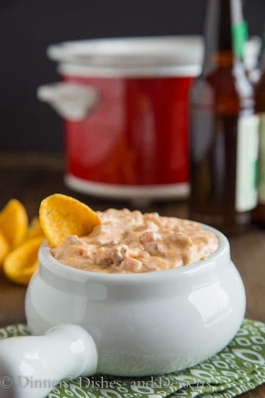 Hot Sausage Dip - a creamy, cheesy, hot sausage dip that is perfect for any get together.  Make ahead and heat in the crock pot for the big game!