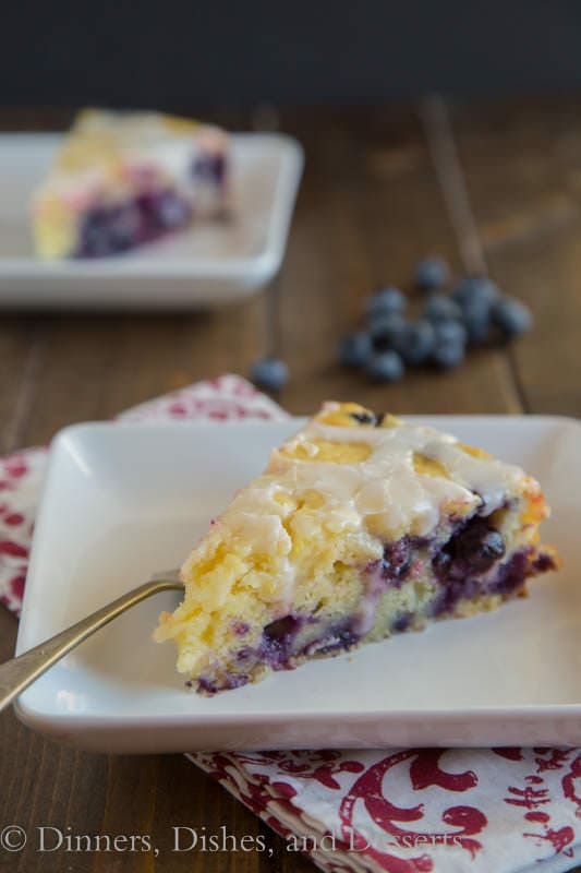 Lemon Blueberry Yogurt Cake - super tender, moist cake with a lemon glaze on top, and lots of blueberries inside!