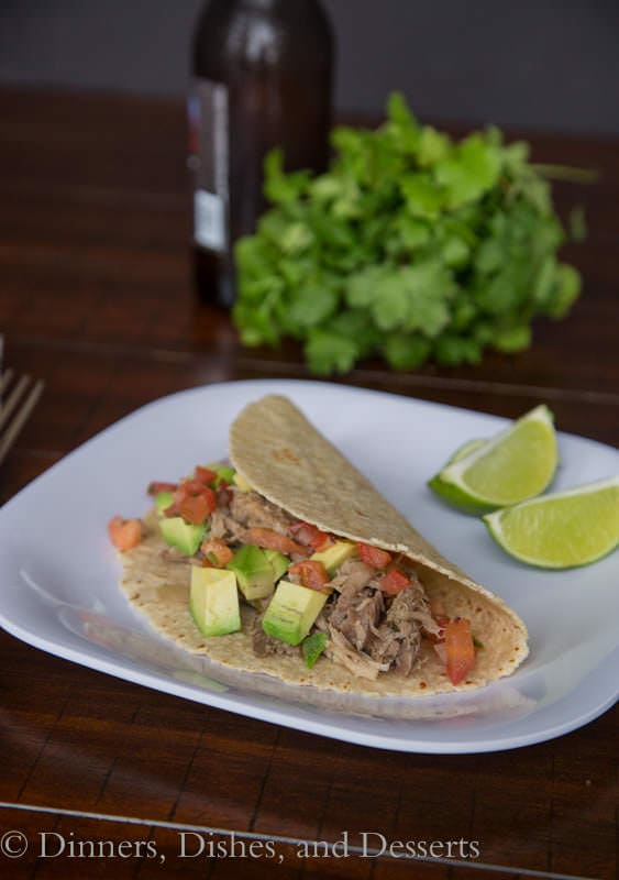 Slow Cooker Pork Carnitas Tacos - Pork that has been cooked in the crock pot in citrus and spices, and then used for tacos.  So easy, and so much flavor!