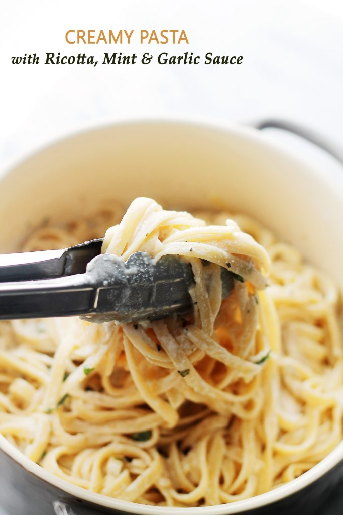 creamy pasta with ricotta mint and garlic sauce in a bowl