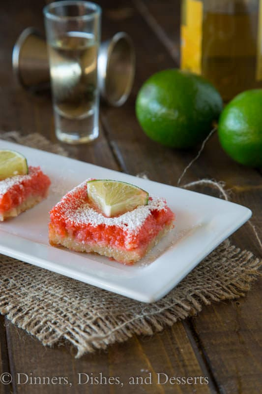 Strawberry Margarita Bars - a twist on a classic lemon bar.  Strawberry, lime, and tequila make these taste like the classic strawberry margarita in dessert form.