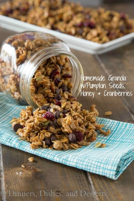 Homemade Granola with Pumpkin Seeds, Honey & Cranberries - homemade crunchy granola made with honey, brown sugar, pecans, pumpkin seeds, cranberries and chocolate chips. Breakfast just got a whole lot better!
