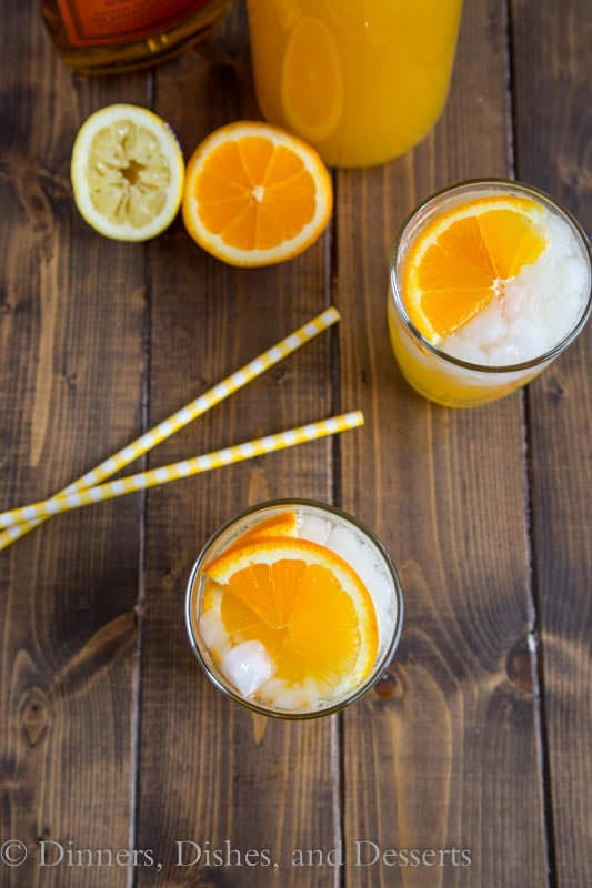Whisky Sour Punch - orange juice, lemon juice and bourbon some together for a fizzy and fun punch.  Great for get togethers, and you can even make it ahead!