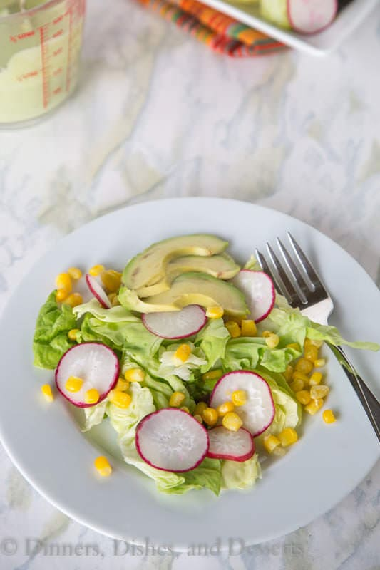 Corn and Radish Salad - An easy radish and corn salad topped with an avocado dressing.  Great use of summer produce!