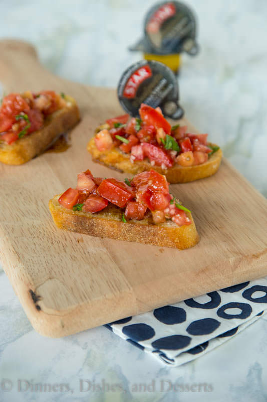 Easy Balsamic Bruschetta - Fresh summer tomatoes make the best bruschetta! Top with single serve balsamic vinaigrette packets, and you can have bruschetta for 1 or many, any night of the week!