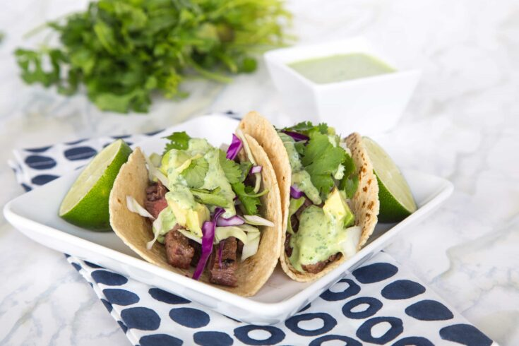 SSteak Street Tacos – tender grilled skirt steak wrapped in a charred corn tortilla and topped with a creamy cilantro lime sauce. Just like Southern California at home in no time!