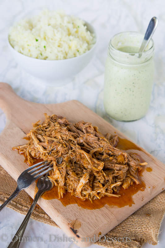 A close up of food on a table, with Pork and Slow cooker