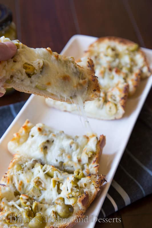 Garlic Olive Cheese Bread - take you garlic bread and turn it up a notch!  Top it with Basil & Garlic flavored olives and lots of cheese!