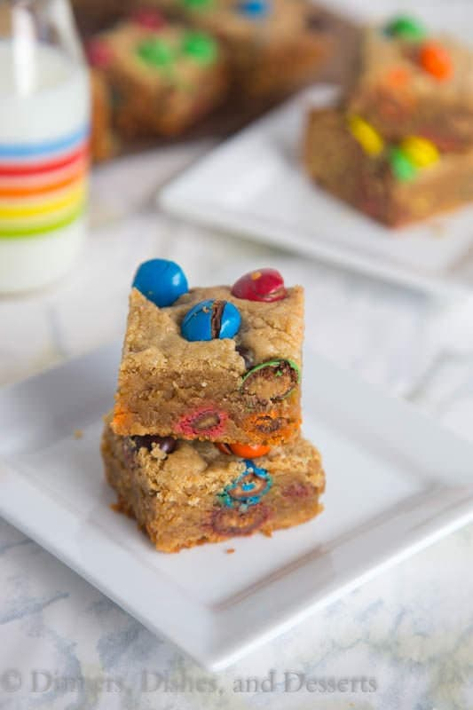M&M Peanut Butter Bars - thick and chewy peanut butter bars loaded with peanut butter M&M's for even more peanut buttery goodness!