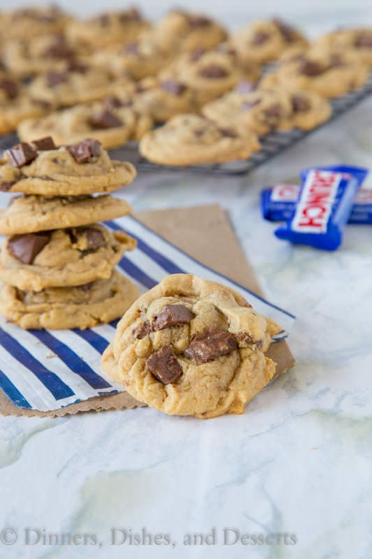Peanut Butter Crunch Cookies - super soft, thick, and chewy peanut butter cookies with lots of pieces of Crunch candy!