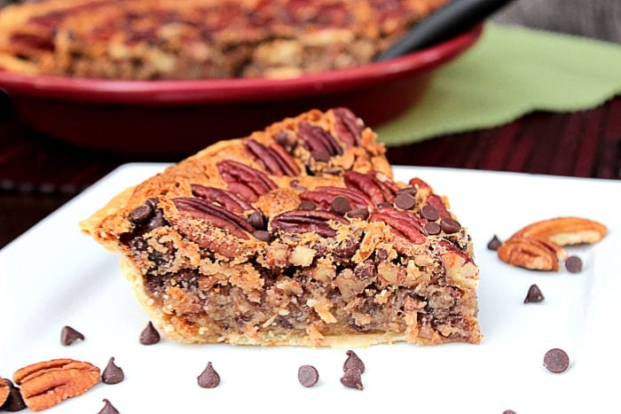 Slice of Chocolate Chip Pecan Pie on a white plate