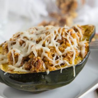 sausage quinoa stuffed squash in a bowl