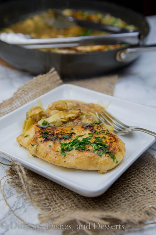 Chicken in Artichoke Pan Sauce - sauteed chicken breasts in a creamy artichoke pan sauce. Ready in minutes and perfect for weeknights!