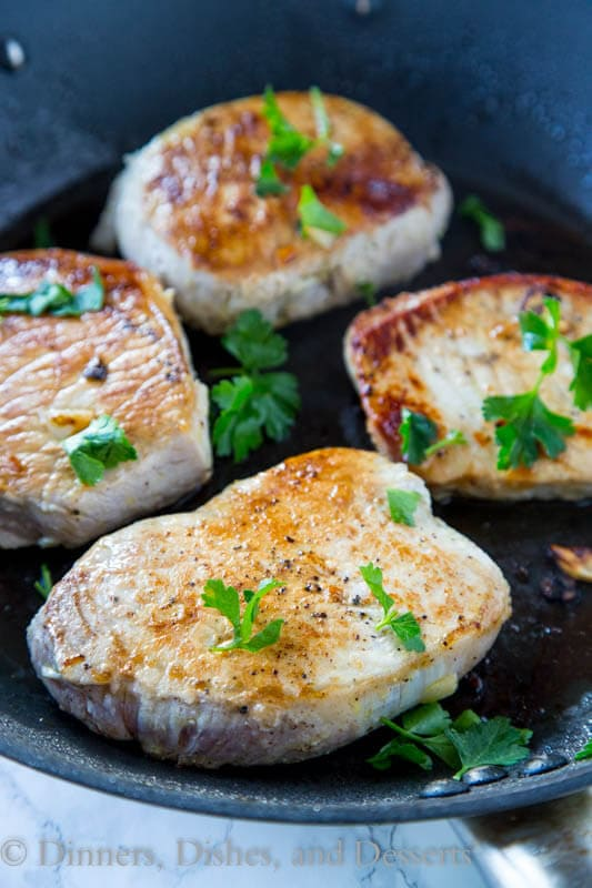 - Thick pork chops marinated in lemon and garlic, and then seared ...
