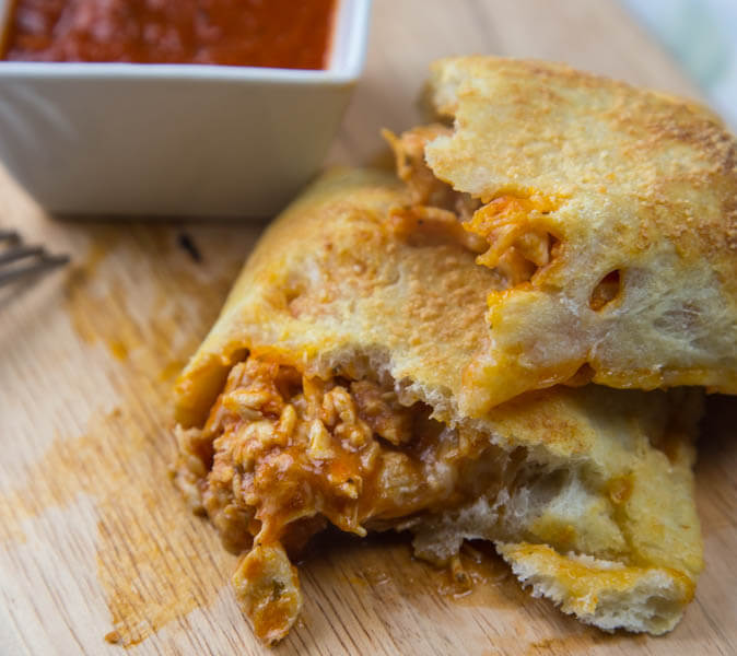 Chicken Parmesan Calzones - Just 5 ingredients until you have all the flavors of chicken parmesan, but in a hand held calzone on a weeknight!
