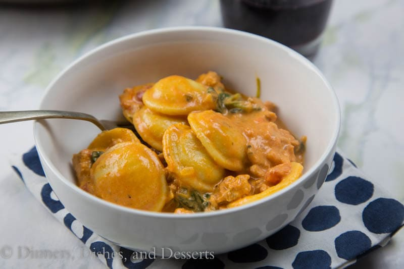 Creamy Sausage and Tomato Ravioli - A creamy one pot pasta with Italian sausage, tomatoes, and fresh spinach, done in 20 minutes!