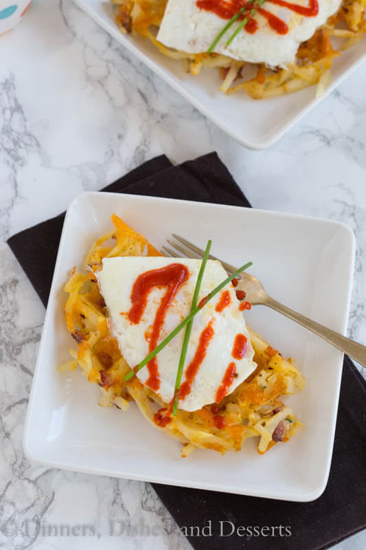 Bacon & Cheese Hash Brown Waffles - Make breakfast for dinner with these hash brown waffles that are crispy on the outside, filled with cheddar cheese and bacon! Top with a fried egg and hot sauce for breakfast perfection!