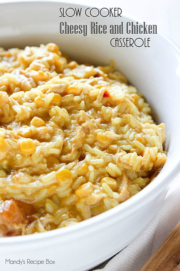 Slow Cooker Cheesy Rice and Chicken Casserole in a white dish