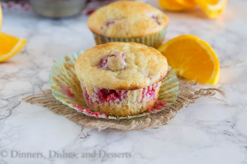 Tangerine Raspberry Muffins - Light and fluffy muffins with lots of fresh juicy raspberries and bursts of tangerine. The perfect way to start the day.