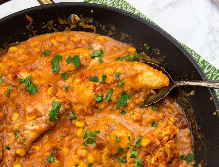 Creamy Salsa Chicken - Taco spiced chicken cooked with corn and salsa, and sour cream mixed into make it creamy and delicious! One pan and 20 minutes!