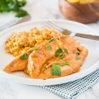 Creamy Salsa Chicken - Taco spiced chicken cooked with corn and salsa, and sour cream mixed in to make it creamy and delicious! One pan and 20 minutes!