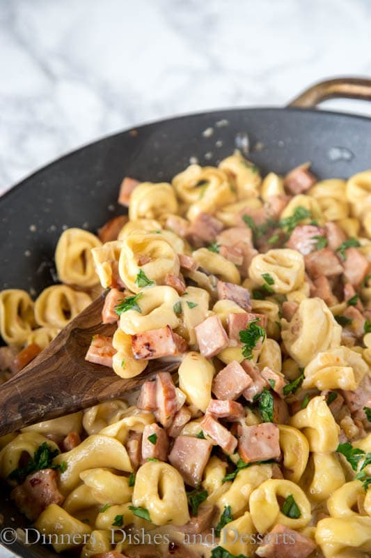 A pan filled with tortellini and ham