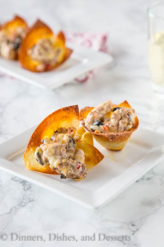 Cheesy Sausage Wonton Cups - Baked crispy wonton cups filled with a cheesy sausage mixture and baked until bubbly and hot. Great for any party, get together, or just because!