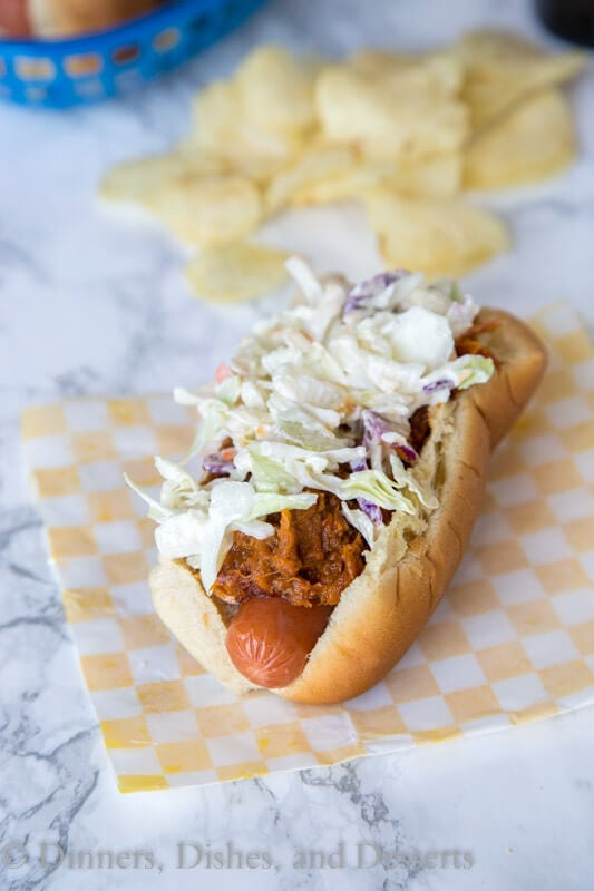 Barbecue Pulled Pork Hot Dogs are a fun way to take your grilled hot dogs up a notch. Everyone will be asking for them all summer long!