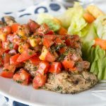 Bruschetta Chicken - chicken marinaded and grilled, then topped it tomato and garlic bruschetta. Healthy, quick, easy, and delicious!