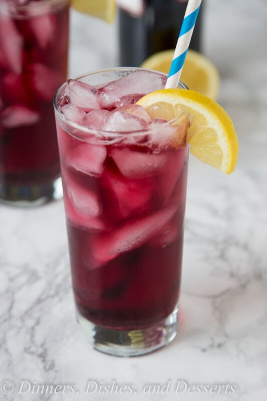 Red Wine Spritzer - a cool and refreshing cocktail you can enjoy anytime of day! So easy, you can make in minutes, with just 2 ingredients!