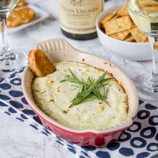 Garlic Herb Baked Goat Cheese Dip - melty, cheesy baked goat cheese dip with lots of garlic and herbs! Pair with a glass of wine and you have the perfect appetizer.