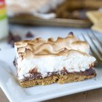 Sheet Pan S'mores Tart - S'mores aren't just for around the campfire, check out this tart with a light marshmallow meringue type topping!