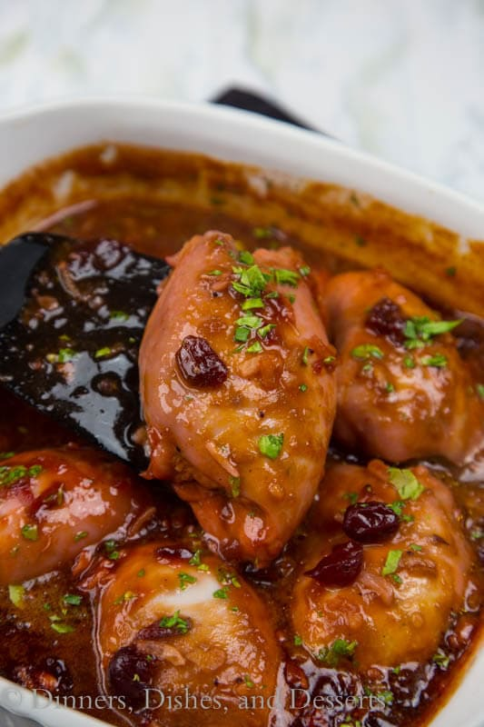 Easy Cranberry Chicken - Moist and tender baked chicken in a tangy cranberry sauce. Great, comforting dinner on busy nights.