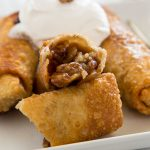 Pecan Pie Egg Rolls - instead of traditional pecan pie, turn it into something fun. Gooey pecan pie filling inside of a crispy egg roll and topped with whipped cream!