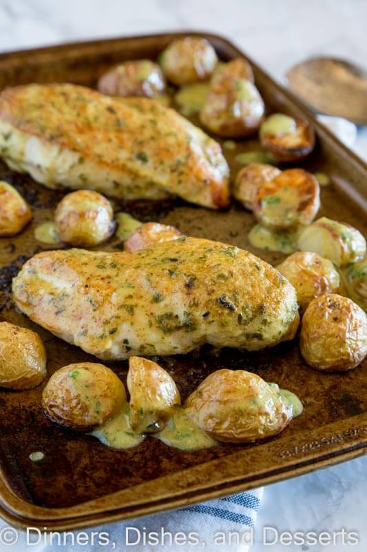 Sheet Pan Chicken with Roasted Potatoes - an easy chicken dinner all made on one sheet pan. Roast chicken and potatoes topped with an herb and mustard sauce.