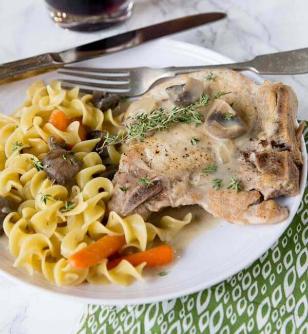 Slow Cooker Pork Chops - use bone in pork chops in the slow cooker for an easy dinner. Add some veggies, and you have a complete meal waiting for you at dinner time!
