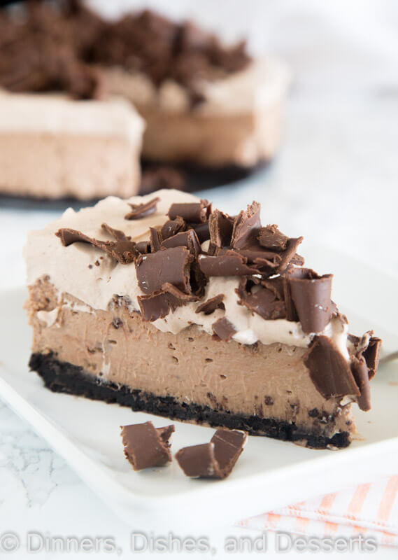Baileys Chocolate Cheesecake - a rich and creamy chocolate cheesecake with the great taste of Baileys Irish Cream. Topped with Baileys whipped cream and plenty of chocolate shavings!