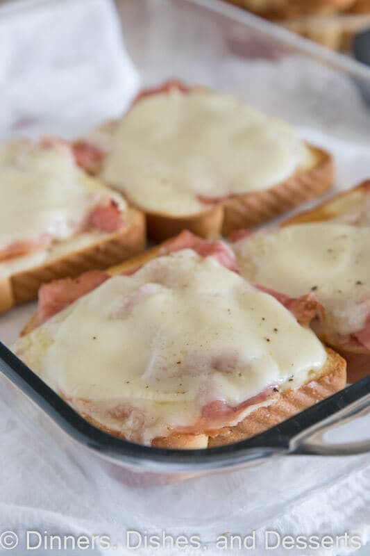 Open Faced Croque Monsieur - traditional croque monsieur sandwich, with sliced ham, Gruyere cheese, mustard and a creamy sauce served open face on soft and tender old fashioned butter bread.