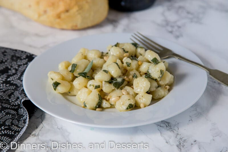 parmesan sage butter gnocchi on a plate with a fork