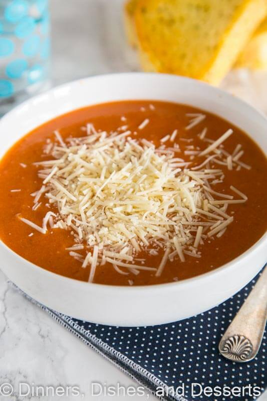 Creamy tomato soup in a bowl with cheese