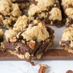 Fudge Nut Bars - an oatmeal cookie base topped with chocolate fudge, lots of nuts, and then more oatmeal cookie baked on top! Gooey and so good!