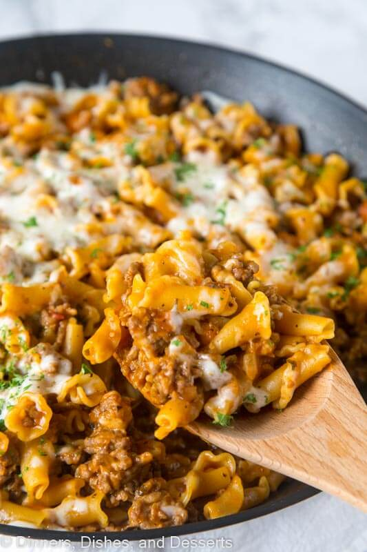 A dish is filled with food, with Hamburger Helper and Sausage