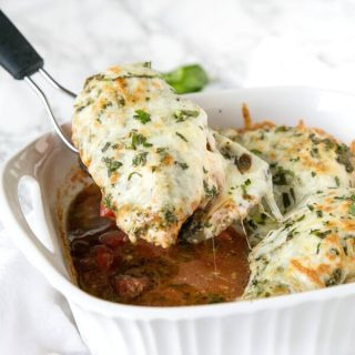 A pan of chicken with cheese
