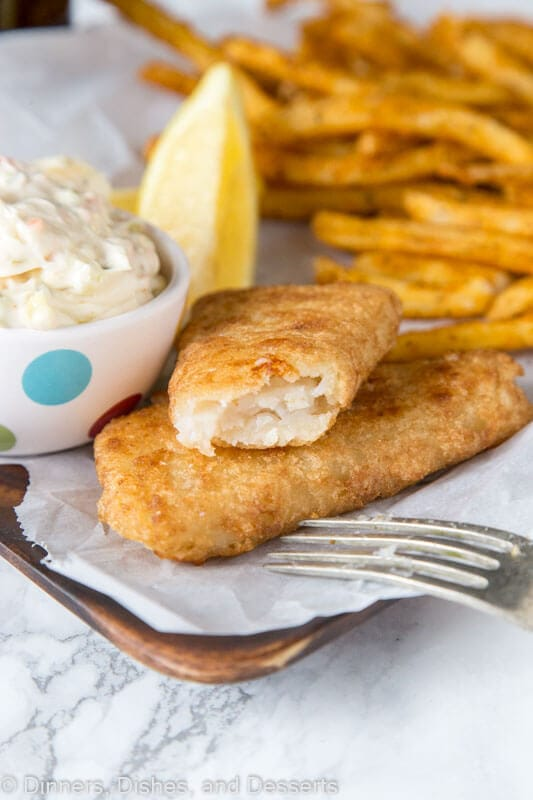 A plate of food, with Tartar sauce and Fish and chips