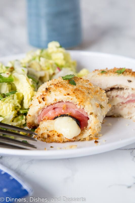 Crispy Chicken Cordon Bleu - thin pieces of chicken with slices of Swiss cheese and sliced ham. Roll them up and dip in bread crumbs for a super crispy crust.