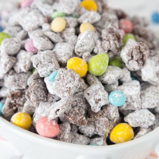 A close up of muddy buddies with easter M&M's